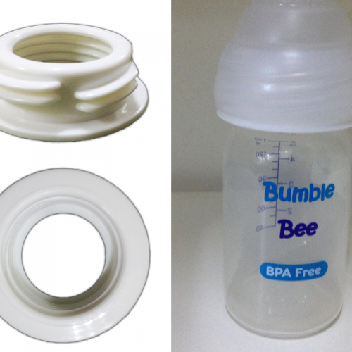 Wide to standard neck bottle adapter